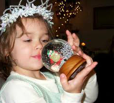 child with snow globe